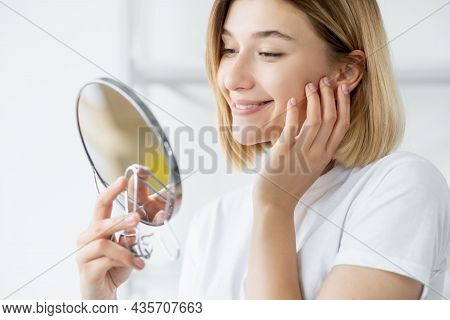 Morning Skincare. Facial Treatment. Skin Rejuvenation. Satisfied Smiling Woman Admiring Radiant Fres