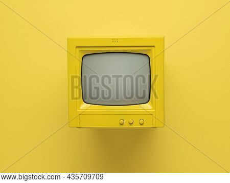 Yellow Retro Monitor With A Ray Tube On A Yellow Background. Retro Equipment. Flat Lay.