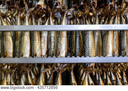 Hot Smoked Mackerel. Delicacy Fish Is Hung In A Special Metal Container.