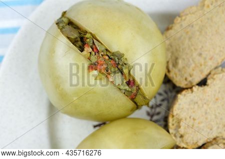 Pickled Green Tomatoes On A Plate Top View. Pickled Green Tomatoes, Stuffed With A Mixture Of Choppe