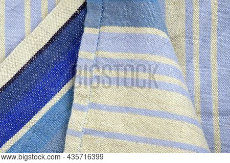 Gray Linen Fabric With A Thin Lilac Strip, Background. Linen Fabric Texture. Kitchen Towel Close-up.