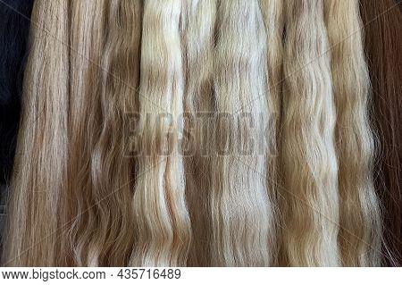 Hair Extensions Closeup. Long, Light Colored Hair. Hair Extensions Color Palette. Natural Blonde Hai