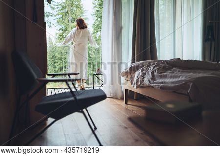 Woman Dressed White Bathrobe Standing On Forest House Balcony And Enjoying Fresh Air And Morning Tea