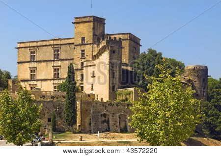 The renaissance Lourmarin Castle ( chateau de lourmarin ), Provence, region of Luberon, France, built between 15th and 16th centuries poster