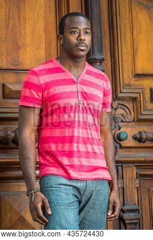 Wearing A Red, Pink Stripe Henley V Neck Shirt, Gray Pants, A Bracelet, A Young Handsome Black Guy W
