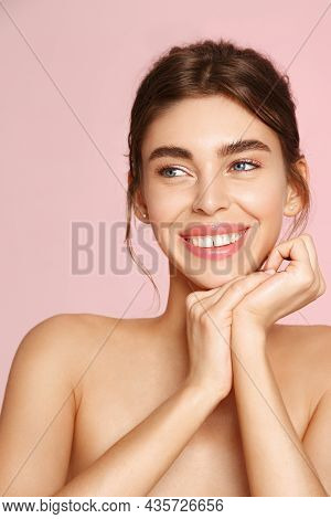 Vertical Portrait Of Beautiful Natural Girl, White Smile And Happy Face, Holding Hands Near Nourishe
