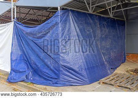 Unfinished Construction Work Covered With Blue Tarp Cover