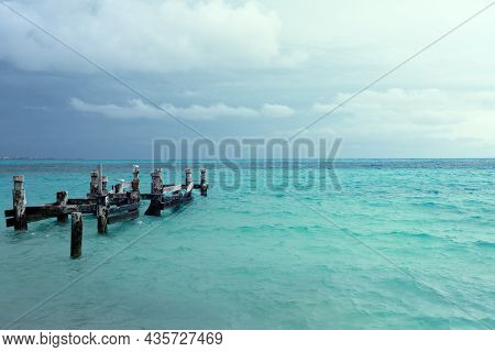 Remains Of An Old Pier On Playa Caracol Beach In Cancun, Mexico