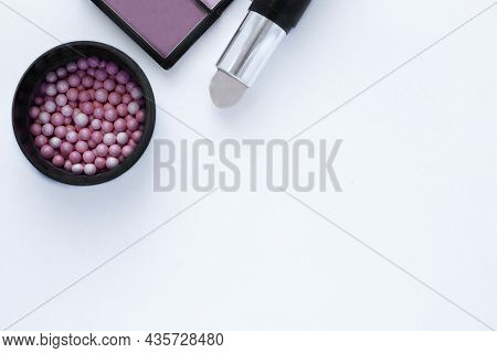 Chocolate-colored Bronzer, Blush Balls And Concealer Background With Space For Text. Top View, Flat