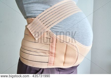 Bandage For A Pregnant Woman. Pregnancy Is The Last Month. Pregnant Woman Wears A Special Bandage, S