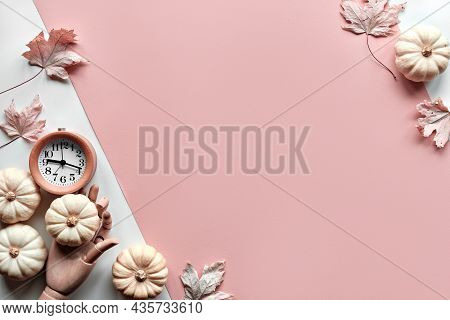 Autumntime Background. Alarm Clock In Wooden Model Hand, And Decorative White Pumpkins. Layered Off