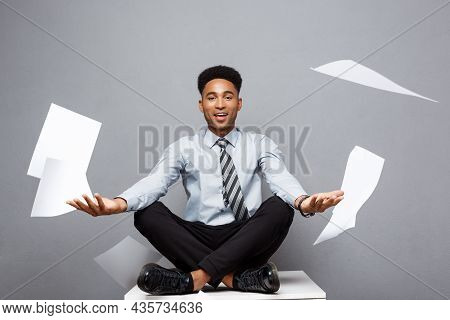 Business Concept - Handsome Young Professional African American Businessman Throwing Away Pile Of Pa
