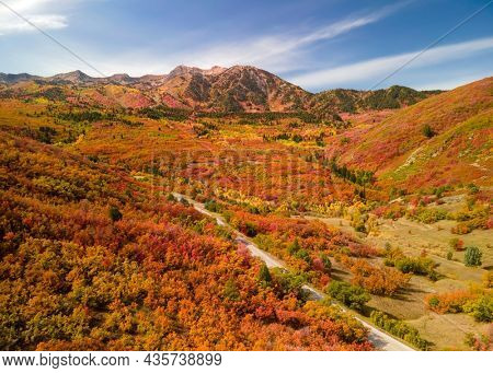 Aerial view of Snow basin in Utah filled with brilliant fall foliage