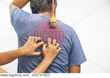 Senior Man And His Wife Scratching His Back