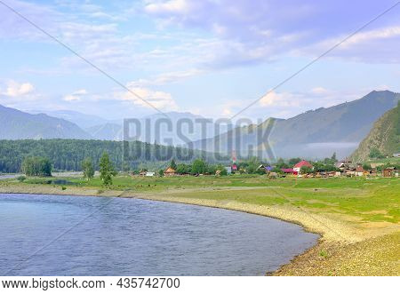 The Bank Of A Mountain River Under A Blue Cloudy Sky. Altai, Siberia, Russia