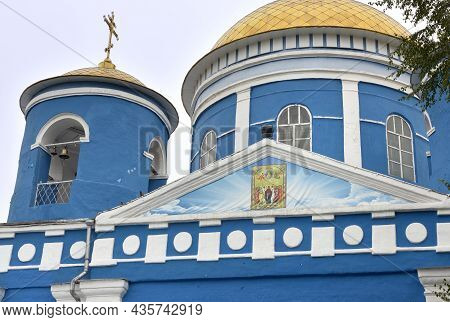 Achinsk, Siberia, Russia -09.01.2021: A Fragment Of The Facade With An Icon On The Background Of Gol