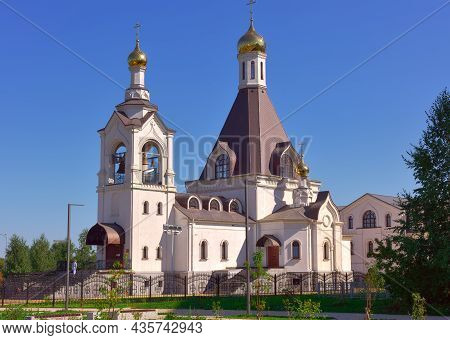 Kemerovo, Siberia, Russia-09.01.2021: A White Temple With Golden Domes Under A Blue Sky