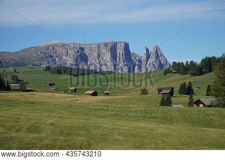 View From Beautiful Green Alp To Distinctive And Famous Dolomite Mountain: Schlern - Sciliar