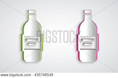 Paper Cut Glass Bottle Of Vodka Icon Isolated On Grey Background. Paper Art Style. Vector