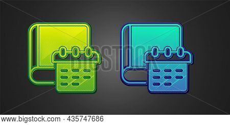 Green And Blue Daily Paper Notepad Icon Isolated On Black Background. Vector