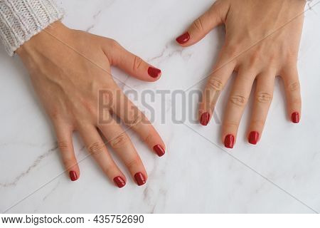 Stylish Red Female Nails. Modern Beautiful Manicure. Autumn Winter Nail Design Concept Of Beauty Tre