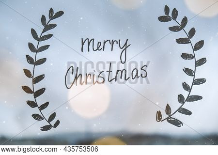 Merry Christmas Drawn On Window Christmas Holidays Decoration Painted On Window Glass. New Years Sce