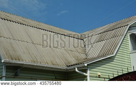 A Close-up Of A Roof Valley, Roofing Problem Area Of A Mansard Asbestos Roof Where Rain Water Leaks