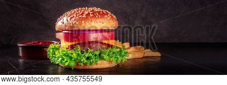 Burger Panorama On A Black Background With Copy Space. Beef Patty Steak With A Salad Leaf, Cheese, V