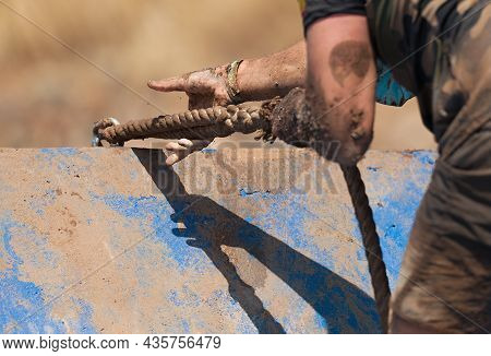 Mud Race Runners, Participant For Overcoming Barriers Through Ropes