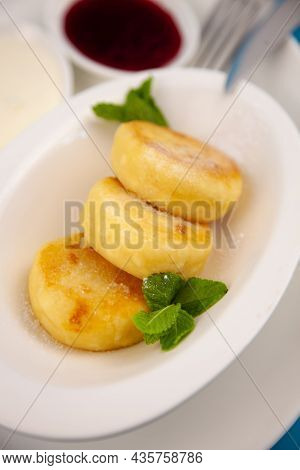 A Portion Of Three Round Curd Cheese Pancakes On A White Plate. Healthy Breakfast. Food Background
