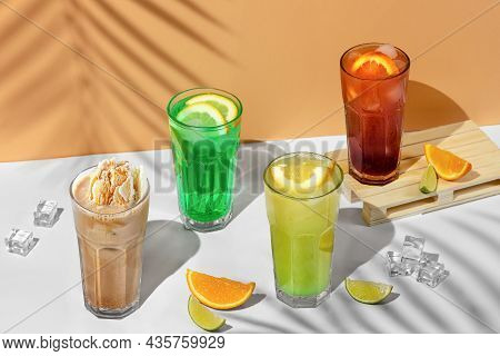 Beautiful Still Life Composition With Four Transparent Glasses Of Summer Drink. Green Lemonade With