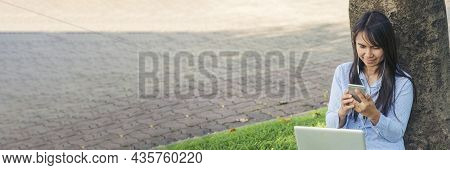 Banner Asian Woman Sitting Green Garden Park Using Phone Listen Music From Smart Phone With Laptop C