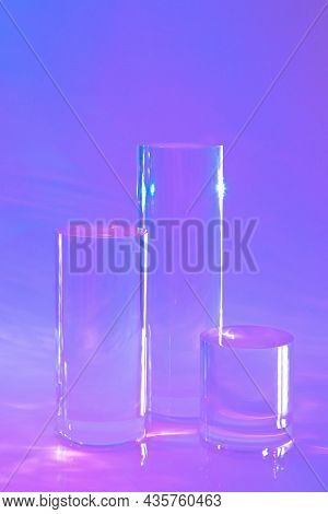Abstract Surreal Scene - Empty Stage With Three Clear Glass Cylinder Podiums On Pastel Holographic N