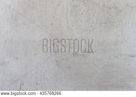White Plaster Whitewash Wall Horizontal Background With Daubs And Fractures. Concrete Wall With Whit
