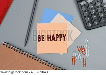 Be Happy - Concept Of Text On Sticky Note. Closeup Of A Personal Agenda. Top View. Office Concept. C