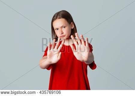 Stop It. Serious Brunette Teen Girl Stretching Out Hands And Showing His Palms While Standing Isolat