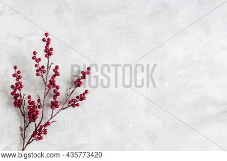 Christmas Composition. Red Berries On Gray Background. Christmas, Winter, New Year Concept. Flat Lay