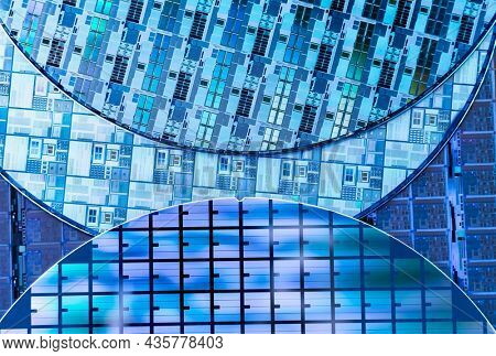 Silicon Wafers with microchips used in electronics for the fabrication of integrated circuits