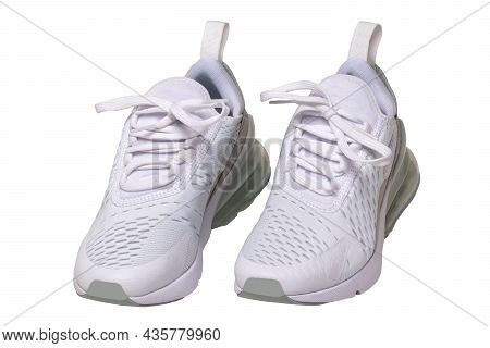 White Sneaker Isolated. Close-up Of A Pair White Elegant Stylish Female Leather High-heeled Sport Sh