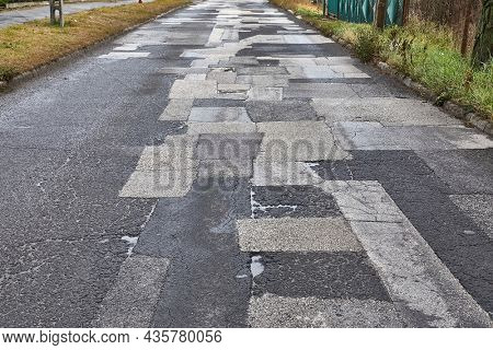 Extremely bad quality road with many patches, potholes