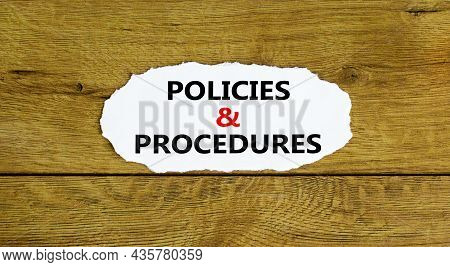 Policies And Procedures Symbol. Words 'policies And Procedures' On White Paper. Beautiful Wooden Bac