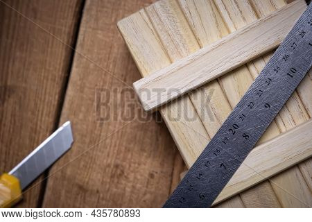 Working Tools Ruler And Stationery Knife On A Working Wooden Table