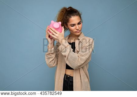 Photo Of Sincere Sad Cute Young Beautiful Attractive Woman With Dark Curly Hair In A Ponytail Wearin