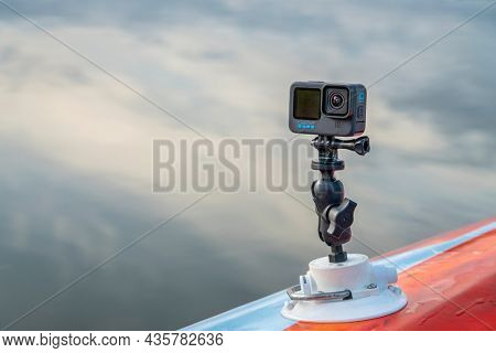 Fort Collins, CO, USA - October 7, 2021: GoPro Hero 10 waterproof action camera mounted with RAM mount and Seasucker suction cup on a deck of paddleboard or kayak.