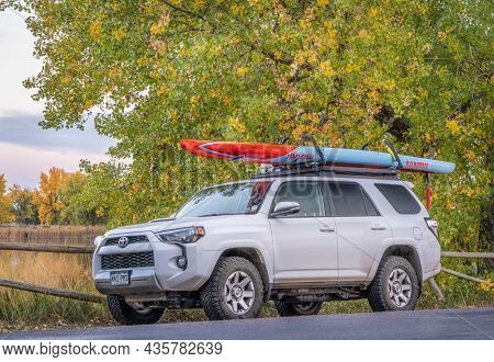 Fort Collins, CO, USA - October 7, 2021: Toyota 4Runner SUV (2016 trail model) with a long racing stand up paddleboard (Stealth Mistral) after paddling in one of Fort Collins natural areas.