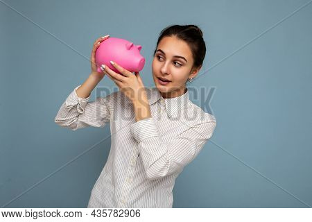 Shot Of Thoughtful Asking Thinking Young Attractive Female Person With Brunette Hair In A Bun With S