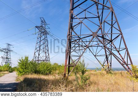 Three Steel Lattice Anchor Transmission Towers Of Overhead Power Lines At The Places Of Transmission