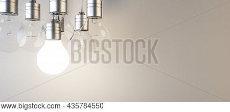 Glowing Lightbulb On Blurry Panoramic Concrete Wall Background. Idea, Innovation, Solution And Inven