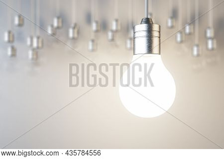 Glowing Lamp On Blurry Concrete Wall Background. Idea, Innovation, Solution And Invention Concept. M