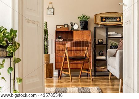 Stylish And Vintage Interior Design Of Open Space With Wooden Retro Cabinet, Design Chair, Sofa, She